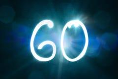 60 светлых год годовщины номера блеска искры стоковые изображения