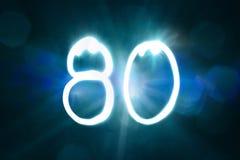 80 светлых год годовщины номера блеска искры стоковые фото