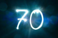 70 светлых год годовщины номера блеска искры стоковое изображение
