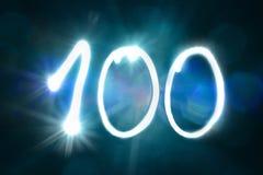 100 светлых год годовщины номера блеска искры стоковые изображения