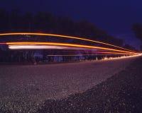 Световые лучи на проселочной дороге стоковые изображения