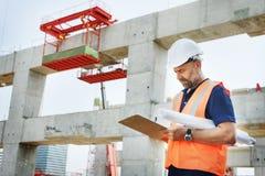 Светокопия инженера строительной площадки работая Стоковое фото RF