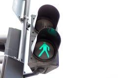 Светофоры при зеленый свет освещенный для пешеходов Изолировано на белизне стоковые изображения rf