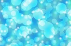 Свет - голубая предпосылка конспекта bokeh/предпосылка bokeh в различных тонах сини Стоковые Фото