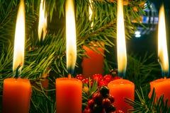Свет горящей свечи рождества Стоковые Изображения