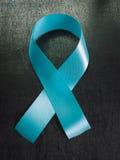Свет - голубая лента как символ осведомленности рака предстательной железы Стоковые Изображения