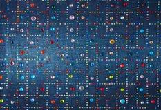 Свет-голубая джинсовая ткань с varicolored стразами Стоковая Фотография RF