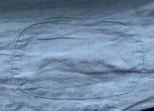 Свет - голубая текстура ткани с предпосылкой заплаты Стоковое Изображение
