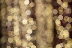 Свет - желтая предпосылка отражения света bokeh Стоковые Изображения