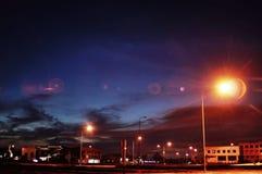 Свет, здание и пирофакел Стоковые Изображения