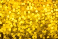 Свет рождества на конспекте золота освещает предпосылку bokeh Стоковые Фотографии RF