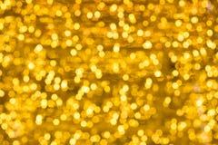 Свет рождества на конспекте золота освещает предпосылку bokeh Стоковое Изображение