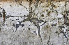 Свет - серая стена гипсолита с темными пятнами Стоковые Фото