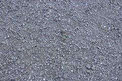 Свет - серый гравий & x28; Pebble& x29; текстура пола, взгляд сверху стоковое фото
