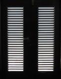 Свет через предкрылки двери Стоковые Фотографии RF