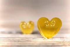 Светлые золотые сердца Стоковые Изображения RF