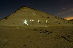 Светлый мучить в пустыне ночи Стоковое Изображение