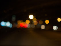 Свет Bokeh в темной предпосылке Стоковая Фотография