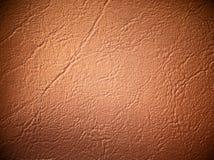 свет leatherette предпосылки коричневый Стоковая Фотография