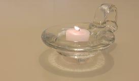 Свеча на стеклянном подсвечнике Стоковые Изображения