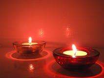 Свечи в прозрачных люстрах Стоковые Фото