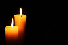 2 свечи осветили налево Стоковые Изображения