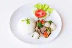 Свинина с зажаренными черным перцем и рисом стоковая фотография rf