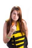 свисток lifejacket девушки Стоковая Фотография