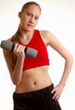 свободный вес удерживания девушки Стоковое фото RF
