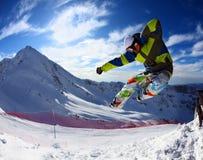 свободный скача snowboarder Стоковые Фото