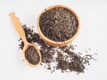 Свободный чай в деревянном блюде с ложкой Стоковое Изображение