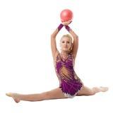 Свободное callisthenics Красивый гимнаст делая разделение Стоковое фото RF
