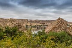 Свод Namibe оазис в пустыне которая обычно заполняет каждые 6 лет в зависимости от дождя anisette вышесказанного Namibe стоковые изображения