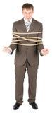 связанная веревочка бизнесмена Стоковое фото RF