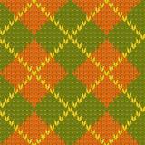 Связанная картина формы диаманта безшовная в зеленом цвете и апельсине, векторе Стоковое Изображение