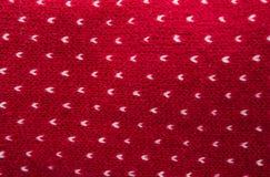 Связанные красный цвет картины/предпосылка текстуры шерстей Стоковые Фотографии RF