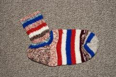 связанные шерсти носок Спицы носков шерстей предпосылки вязать стоковое изображение rf