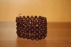 Связанный деревянный коричневый браслет Стоковое Изображение RF