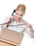 связанный телефон кабеля коммерсантки Стоковая Фотография