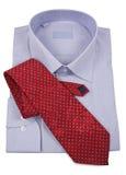 связь рубашки голубого красного цвета Стоковые Изображения