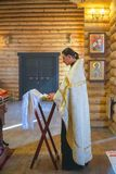 Священник за аналоем стоковые фото