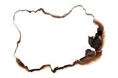 сгорели бумага отверстия пожара белая стоковое изображение rf