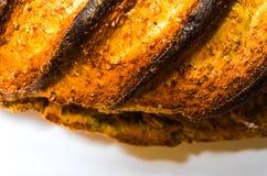 Сгорели хлеб на белой предпосылке Стоковое Изображение RF