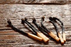 Сгорели деревянные Matchsticks Стоковые Изображения