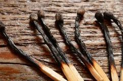 Сгорели деревянные Matchsticks Стоковая Фотография RF