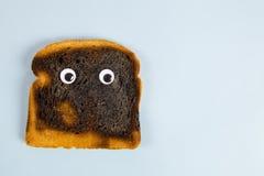 Сгорели хлеб, который Стоковые Изображения