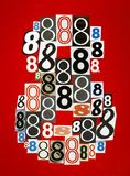 8 сделал от номеров режа от кассет на красном bac Стоковая Фотография