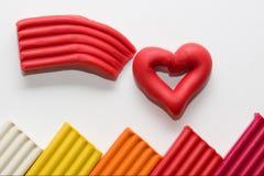 Сделанный сердца пластилина стоковое фото rf
