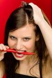 сдержите детенышей женщины портрета перца chili красных пряных Стоковые Фотографии RF