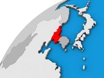 Северная Корея на глобусе 3D иллюстрация штока